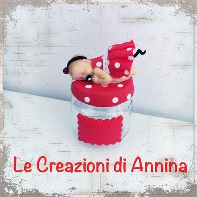 Bomboniera bebè Minnie in pasta di mais su barattolino di vetro
