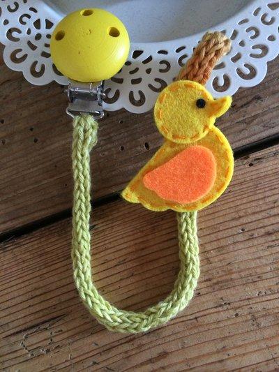 Porta-ciuccio giallo in cotone bio lavorato a tricotin e decoro in feltro