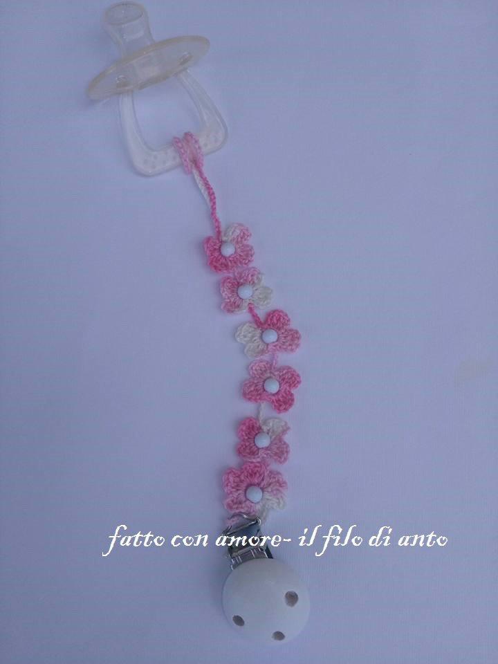 Catenella porta ciuccio a fiori fucsia