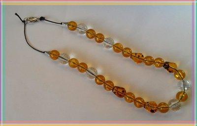 Collana lunga con perle gialle ambra e trasparenti