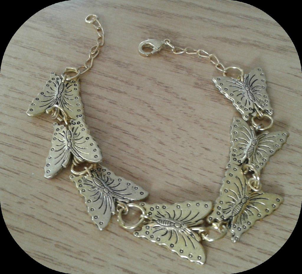 Bracciale farfalle in metallo dorato