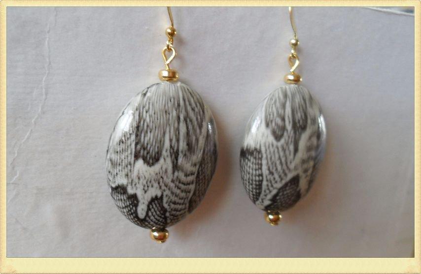 Orecchini perle ovali pitone