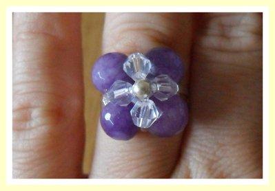 Anello fiore viola e trasparente regolabile