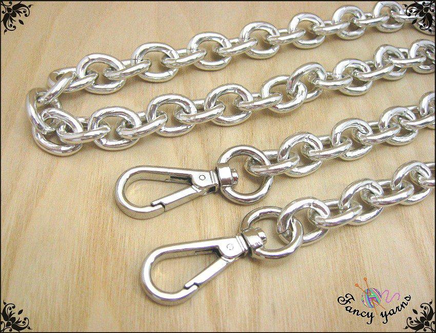 Catena per borsa, lunga 60 cm. x mm.14, maglia forzatina, colore argento, moschettoni extra lusso