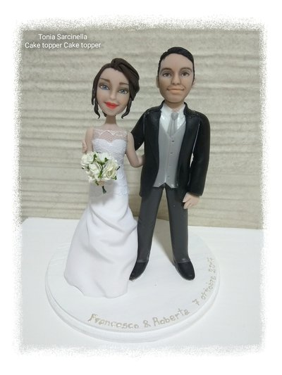 Scultura cake topper sposi caricature in porcellana