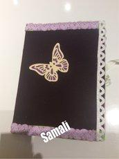 Quaderno in velluto e farfalla
