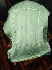 Delicata copertina di colore verde chiaro con fiocchetti e brillantini