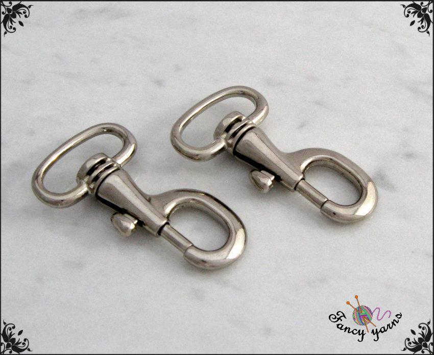 2 Moschettoni in metallo colore argento, lunghi mm.46, spazio interno mm. 20