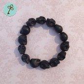 Bracciale elastico con perle nere in vetro - teschio