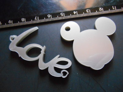 OUTLET -  N. 2 ciondoli in plexiglass argento satinato