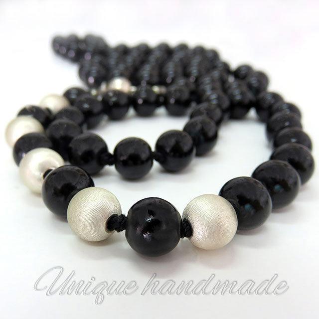 nuovo prodotto 9a5a7 86959 Collana di perle nere