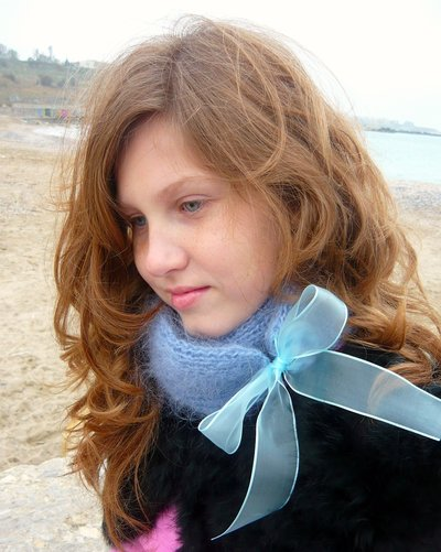 Blue knitted scarf with organza bow