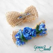 Spilla in stile country, con fiocco di juta e decorazione in fimo e fiori