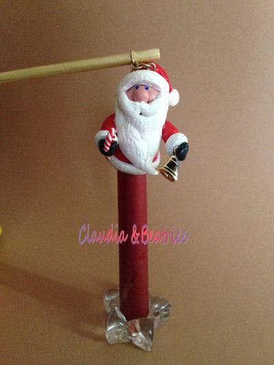 Babbo Natale spegni candela fatto a mano in fimo. Originale accessorio da regalare o regalarsi per Natale.